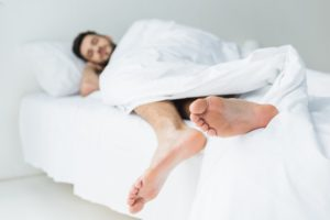 Tall Man In Bed